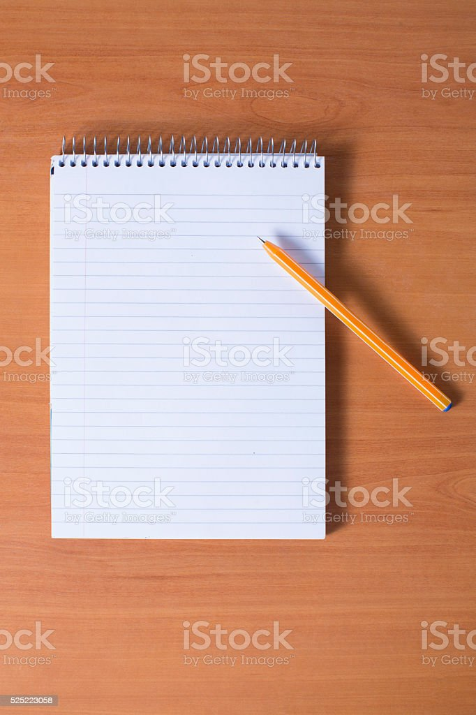 blank notebook with pen stock photo
