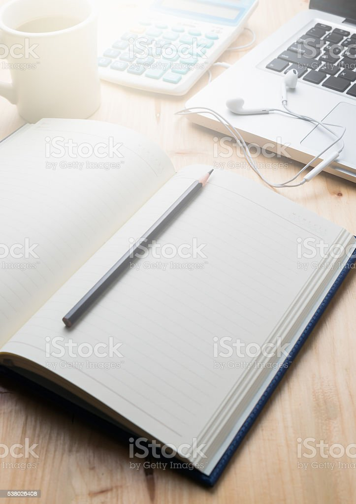 blank notebook with pencil and laptop stock photo
