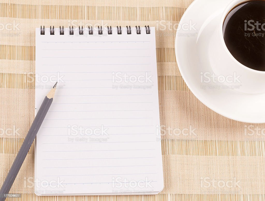 Blank notepad and a coffee royalty-free stock photo