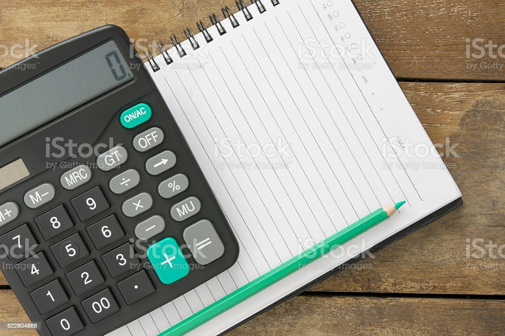 Blank notepad, calculator and pen laying stock photo