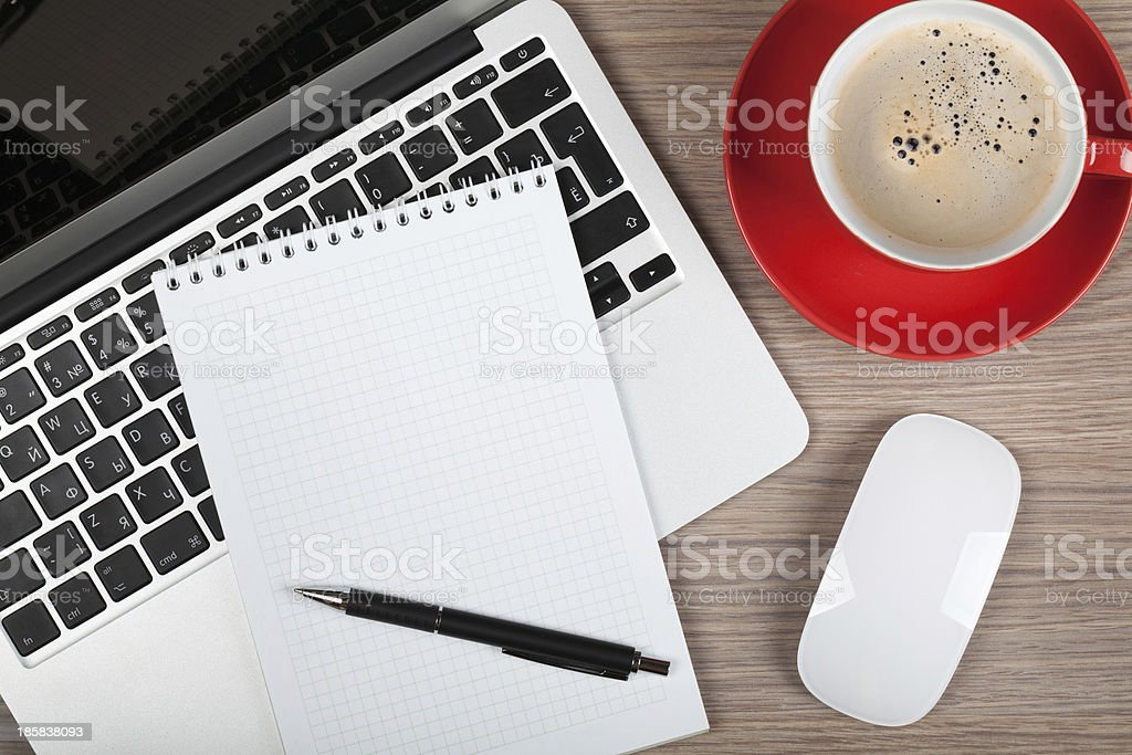Blank notepad over laptop and coffee cup stock photo