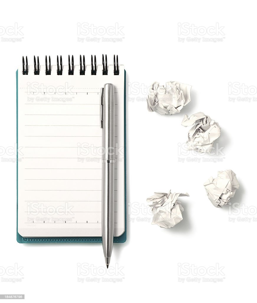 Blank notepad with crumpled papers stock photo