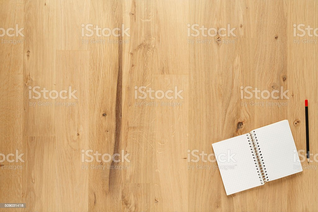 Blank notepad with  pencil on old  wooden table background stock photo