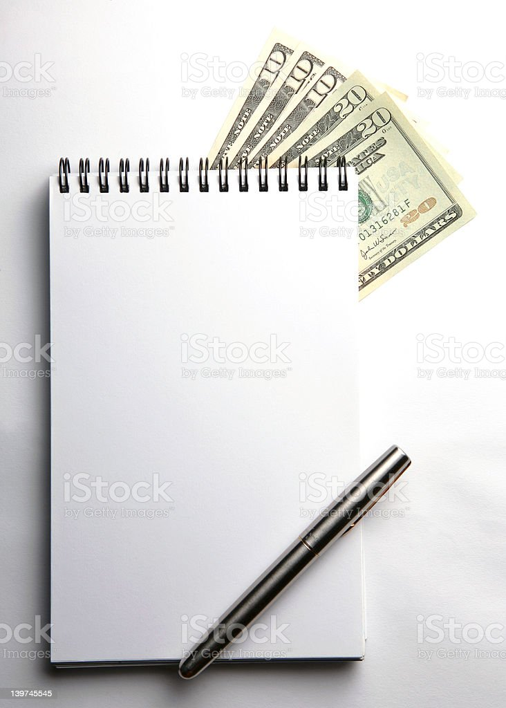 blank notepad with US currencies stock photo