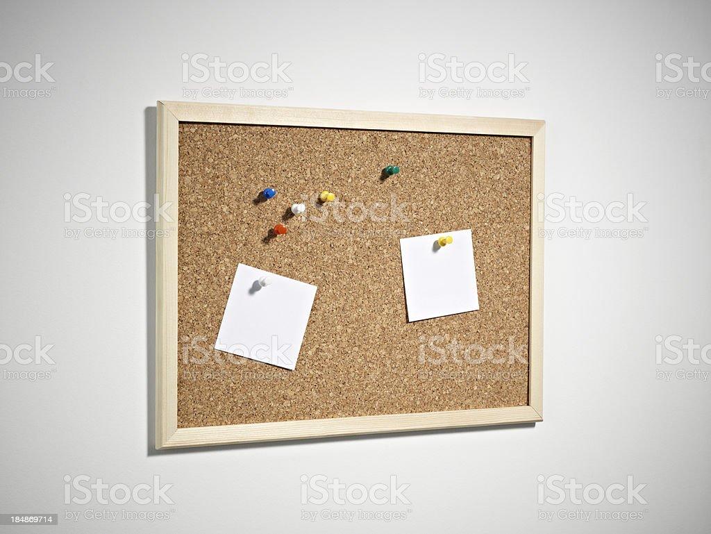 Blank notes thumb tacked on bulletin board stock photo