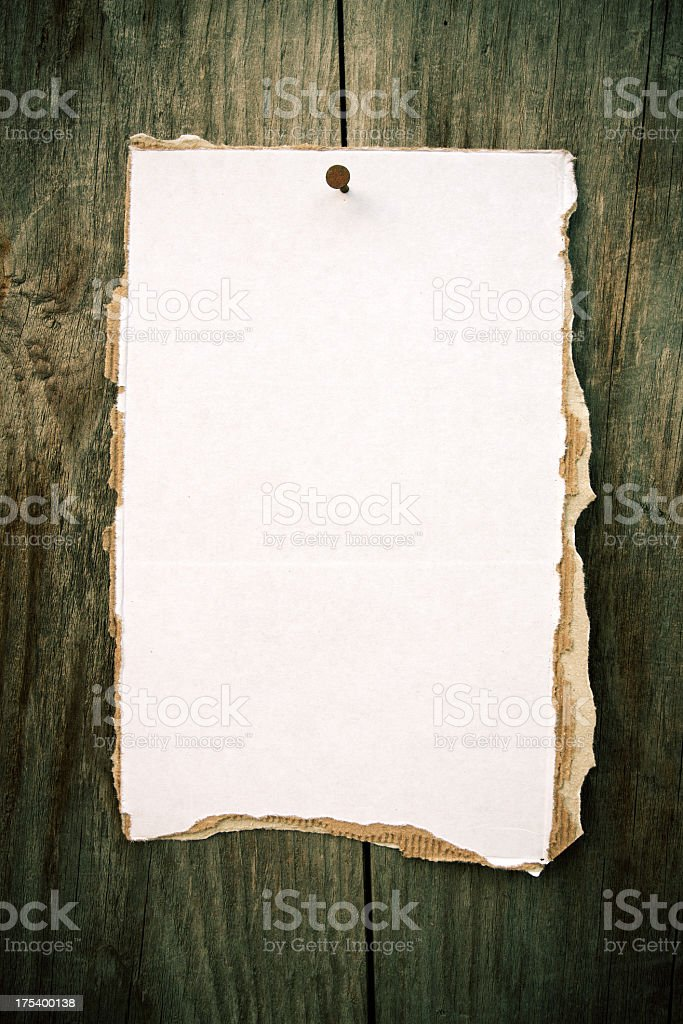 Blank Notice Tacked to a Wood Wall royalty-free stock photo