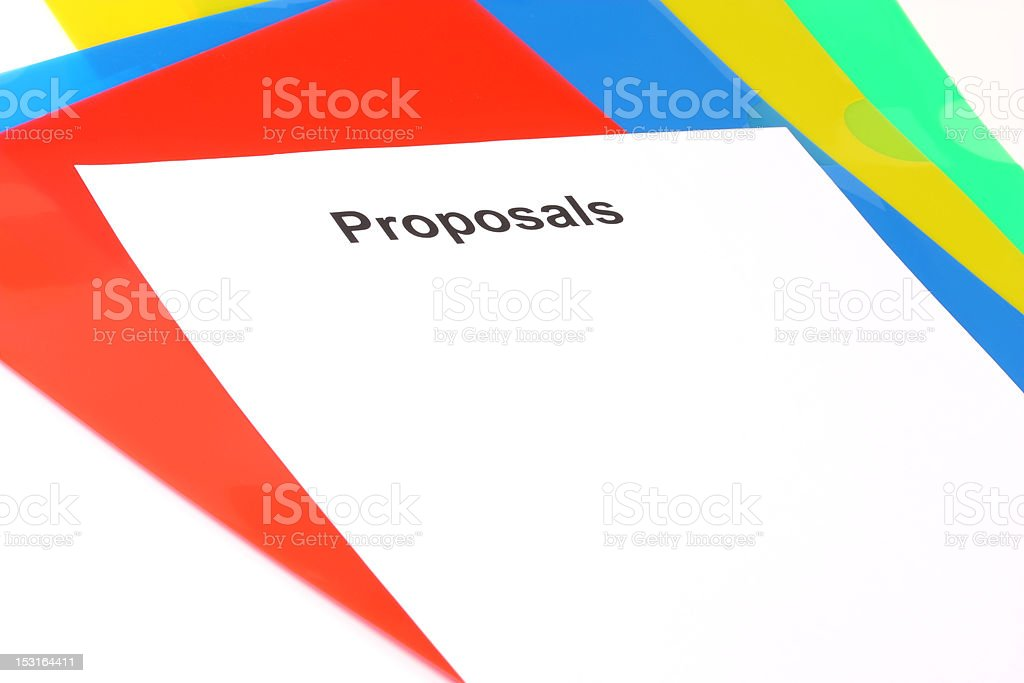 Blank of proposals lying on plastic colored files royalty-free stock photo