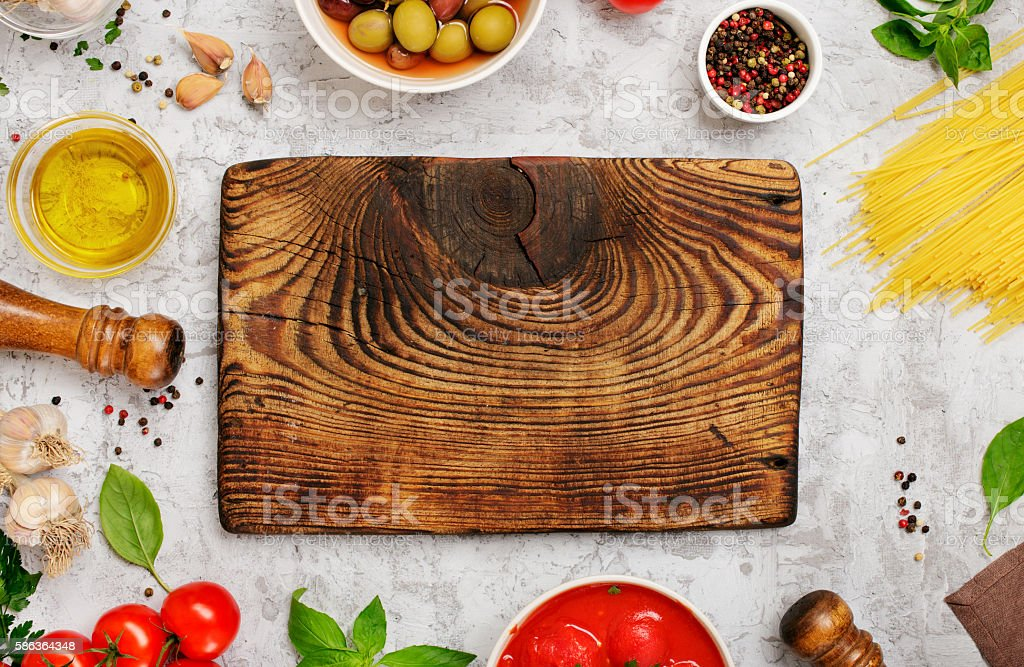 Blank old wooden board with ingredients for cooking Italian past stock photo