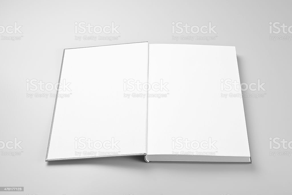 Blank open book over gray background stock photo