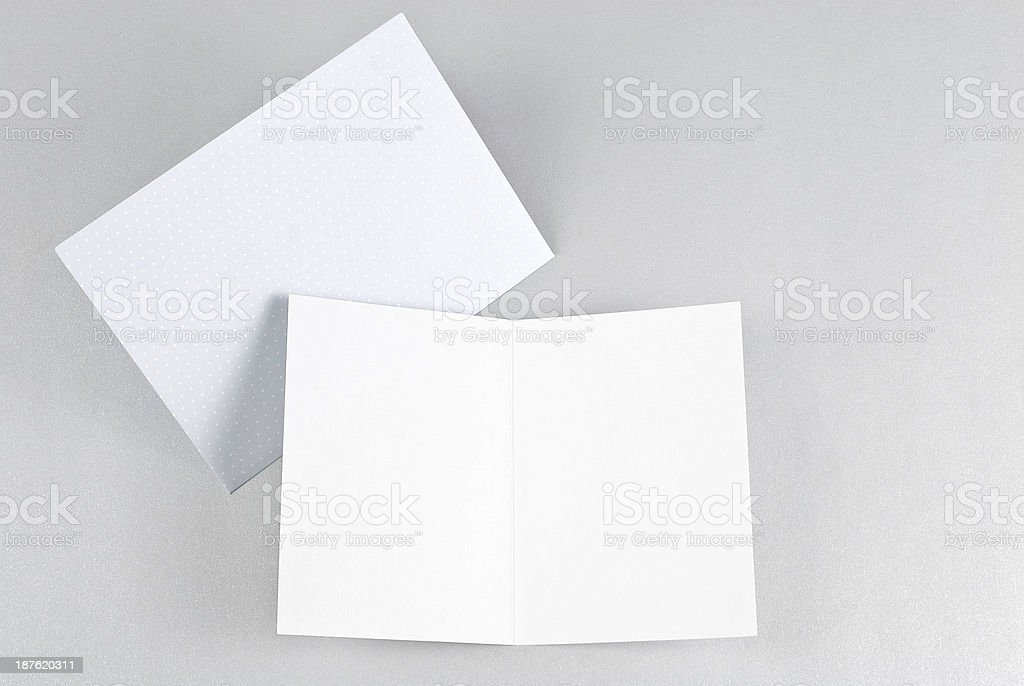 Blank open card and blue envelope royalty-free stock photo