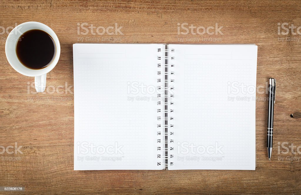 Blank open notebook with pen and coffee on wood table stock photo