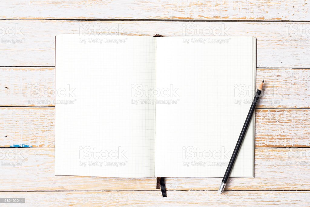 Blank open notebook with pencil on wood table stock photo