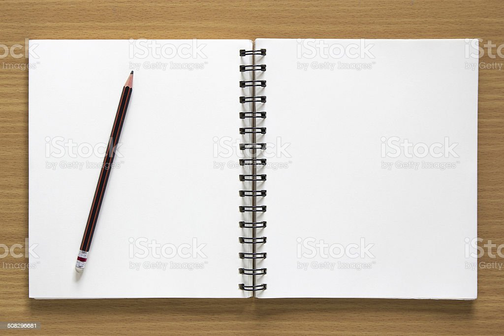 blank open spiral notepad and pencil stock photo