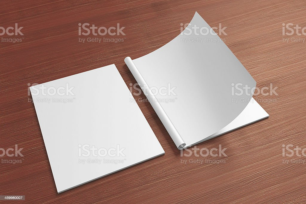 Blank opened magazine on a wooden background stock photo