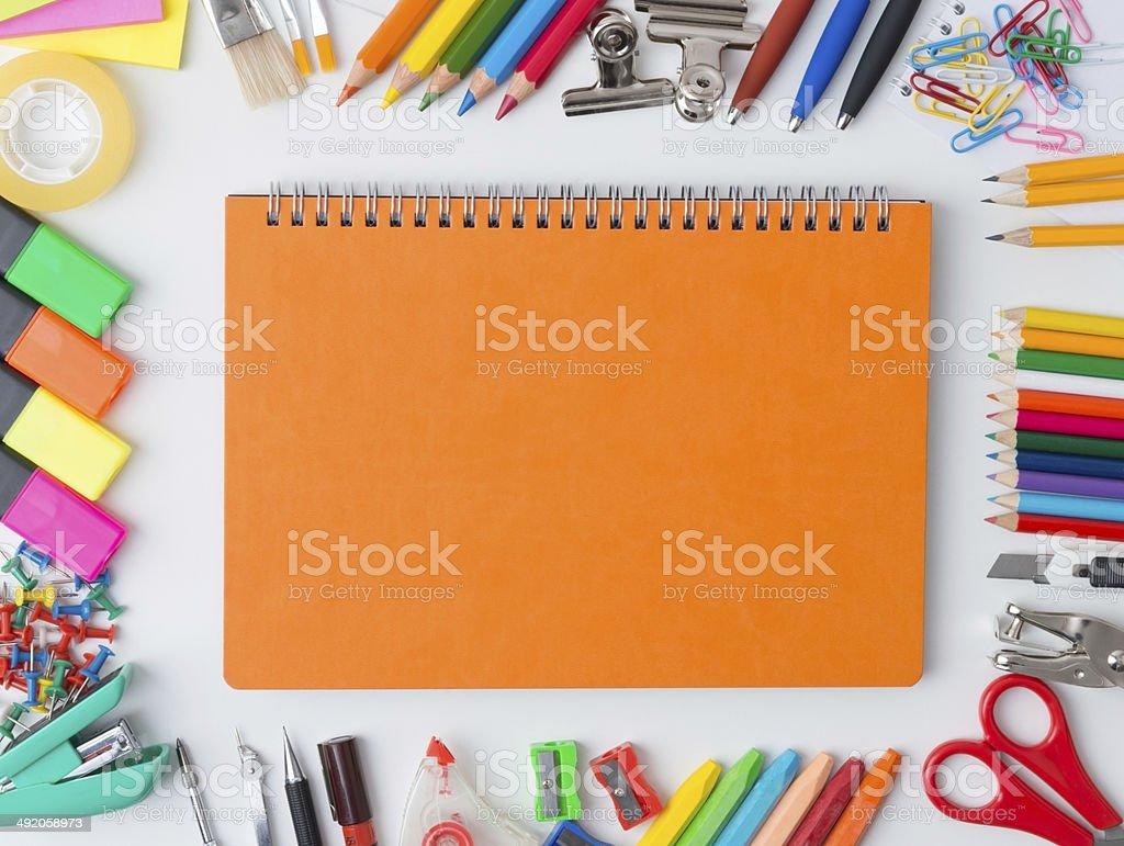 Blank orange notebook with colourful crayons royalty-free stock photo