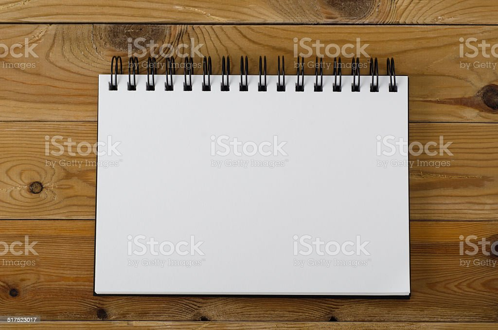 Blank Page Notebook on Wood stock photo