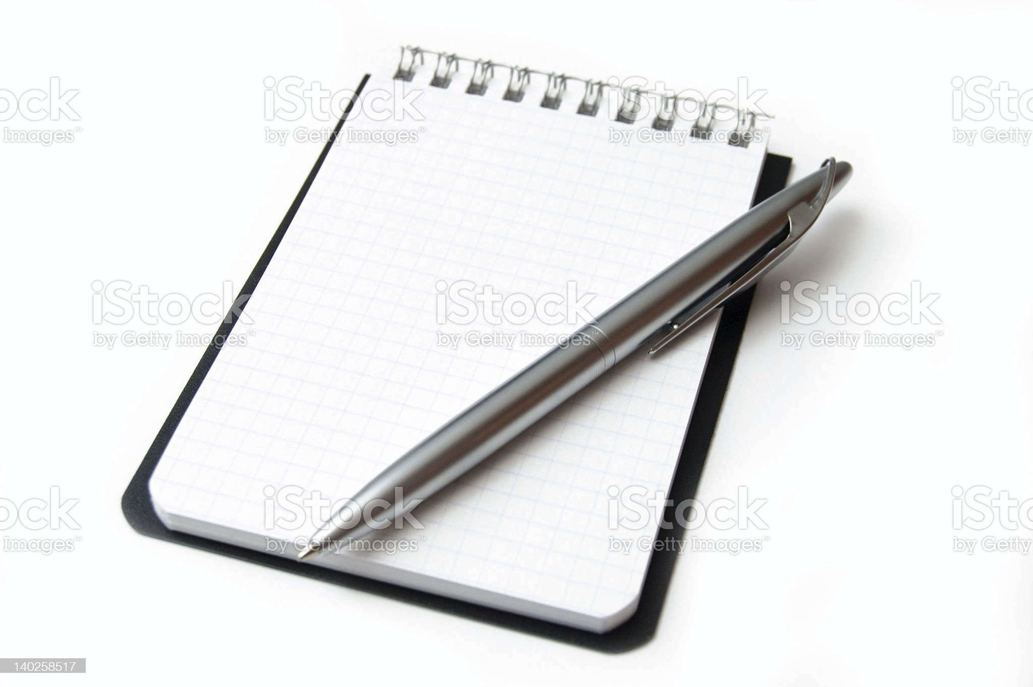 Blank page of a notebook with pen on a white background royalty-free stock photo