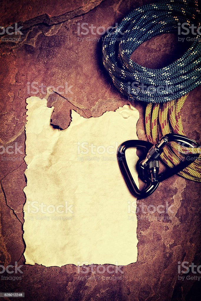 Blank Page Surrounded by Climbing Equipment on Red Rock stock photo