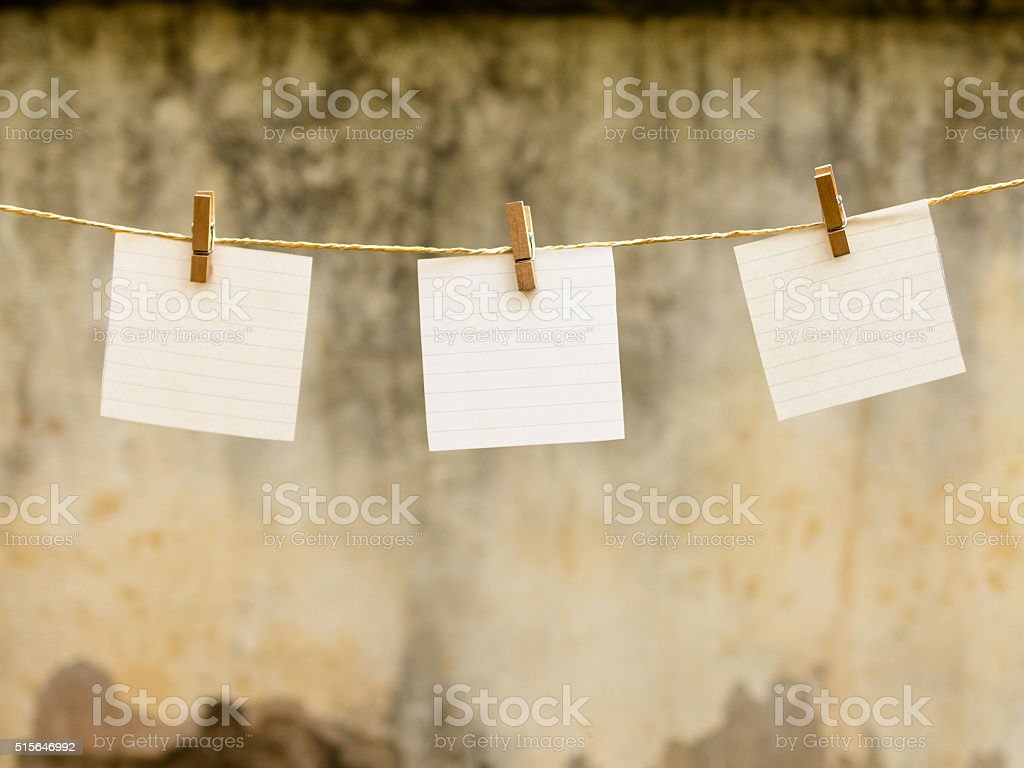 blank paper and clothespin attached to a rope stock photo