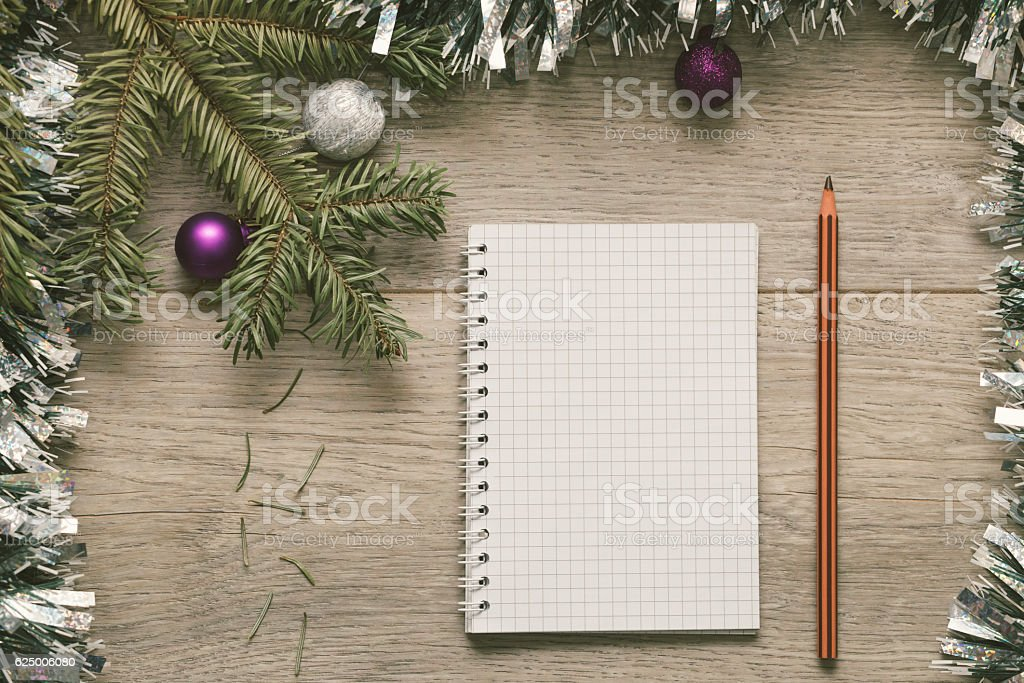 Blank paper and pen framed with Christmas decorations stock photo