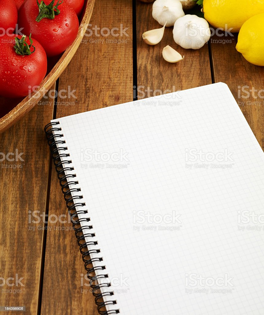 Blank paper book on wood desk with fruits royalty-free stock photo