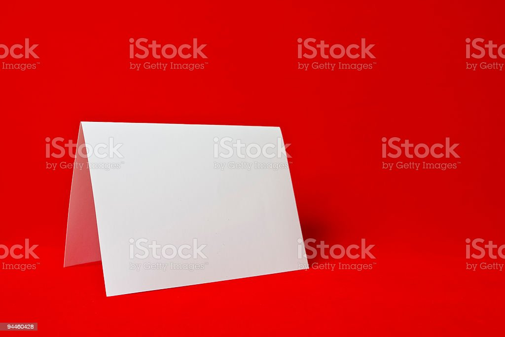 blank paper card on red background royalty-free stock photo