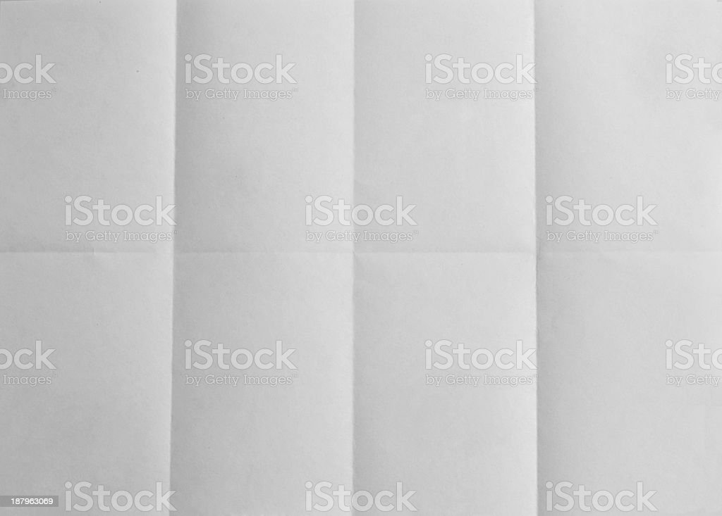 Blank paper folded on eight. Background stock photo