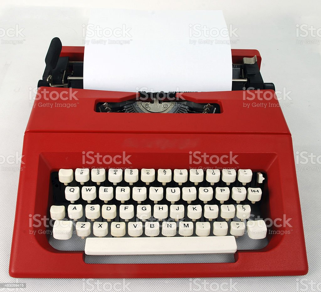 blank paper in red typewriter royalty-free stock photo