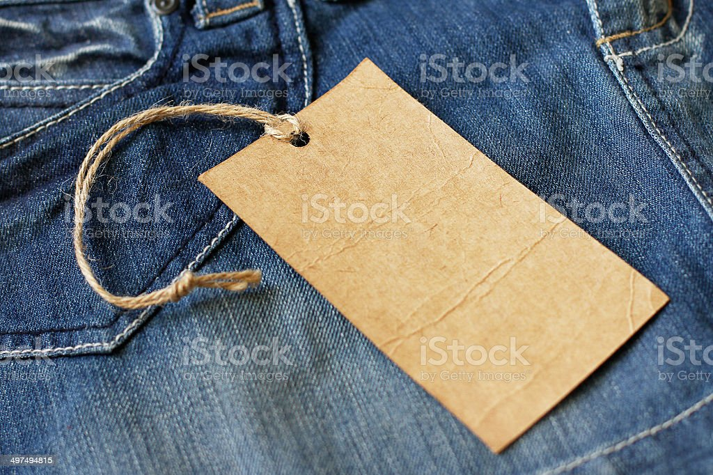 Blank paper label tag on jeans stock photo
