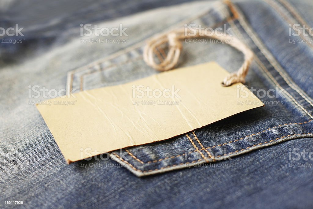 Blank paper label with string on jeans royalty-free stock photo