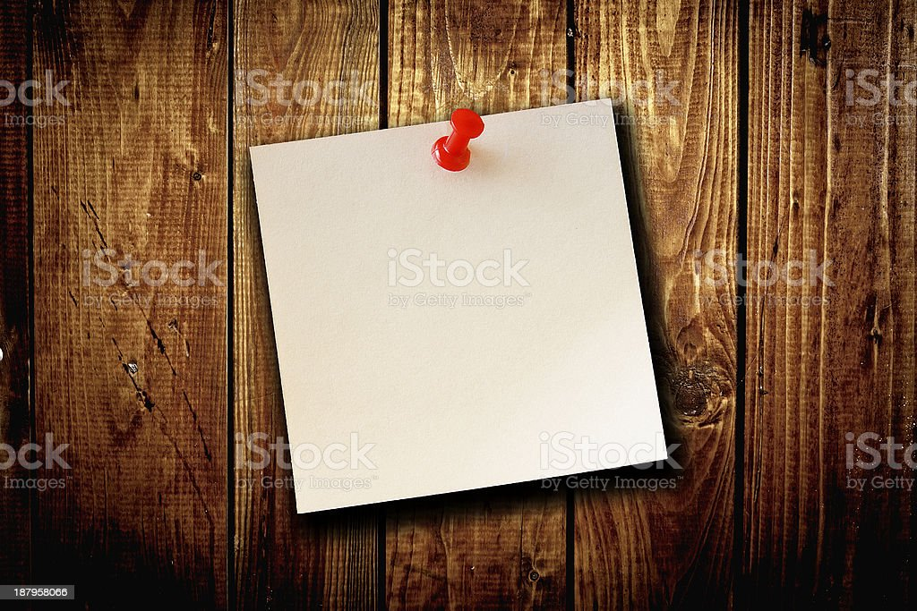 blank paper note on wood board background stock photo