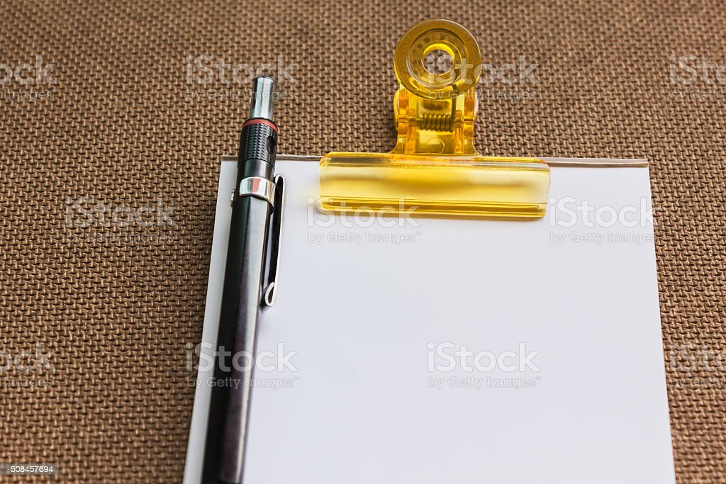 Blank paper note with pencil on wood plate stock photo