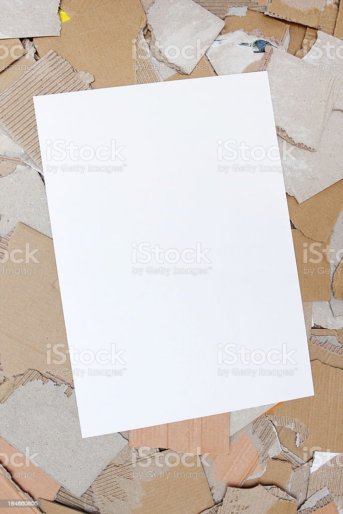 Blank paper on cardboard scrap royalty-free stock photo