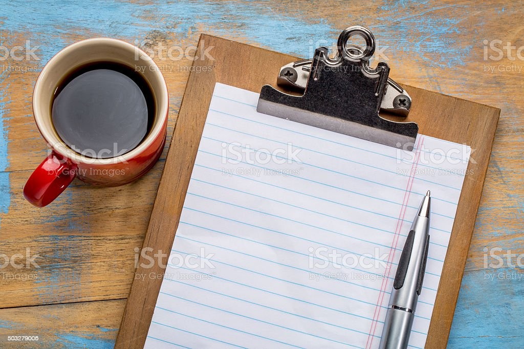 blank paper on clipboard and coffee stock photo