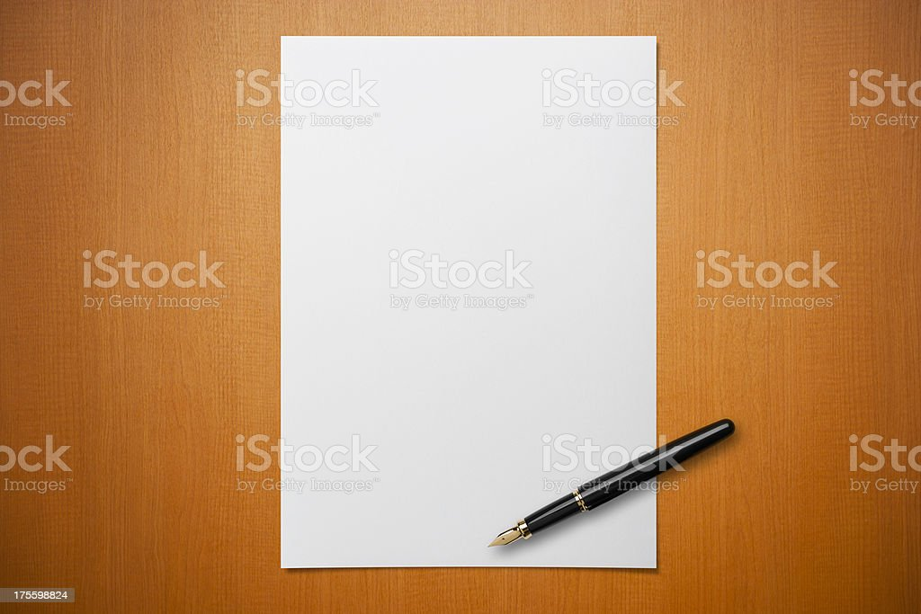 Blank paper on Desk with a pen stock photo