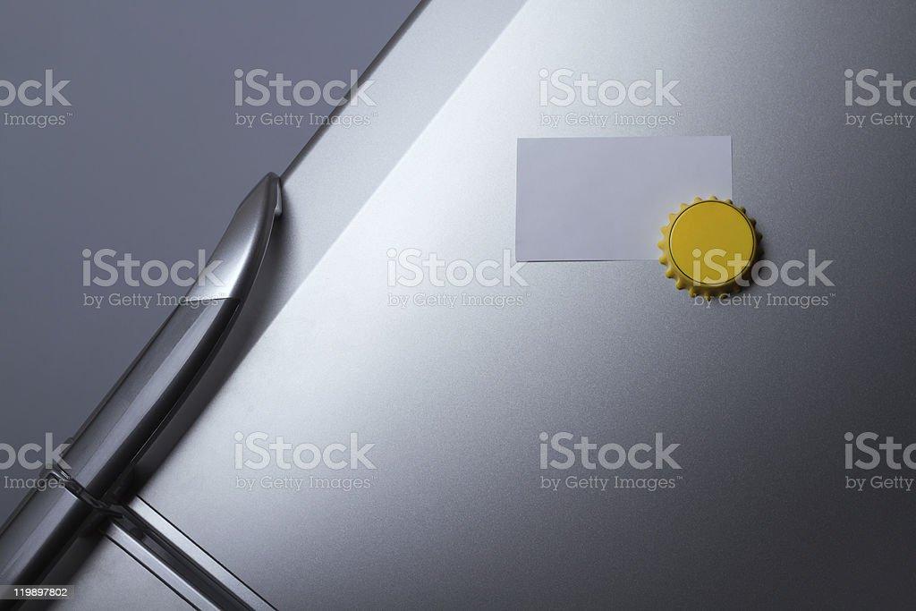 Blank paper on refrigerator door stock photo