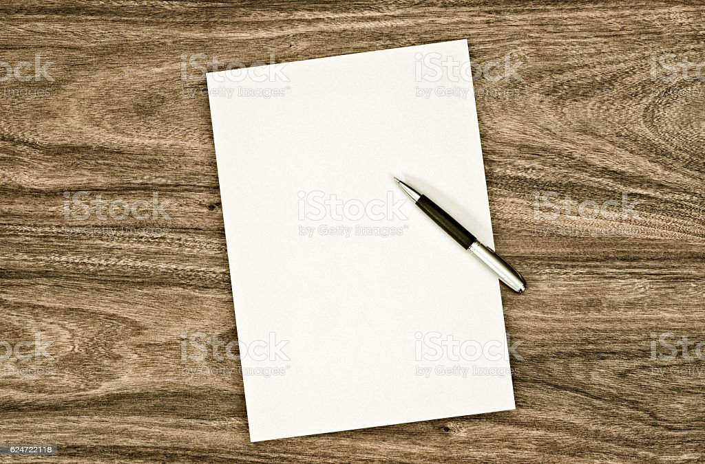 blank paper on the desk stock photo