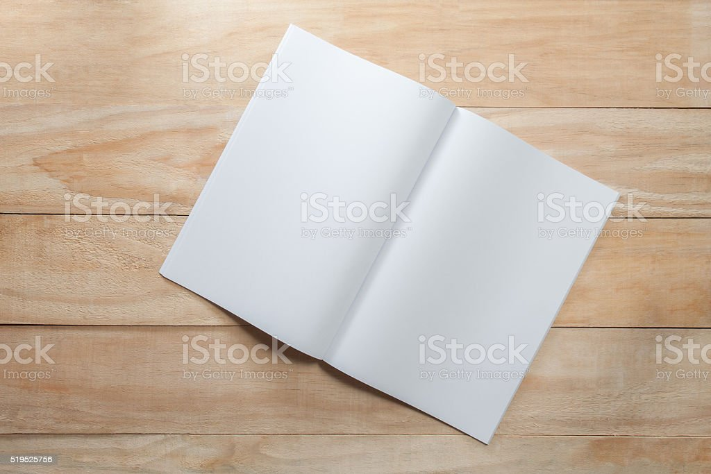 Blank paper or book mock up on wood background stock photo