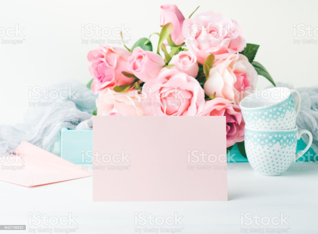 Blank paper pink card Valentine's day and roses invitation stock photo
