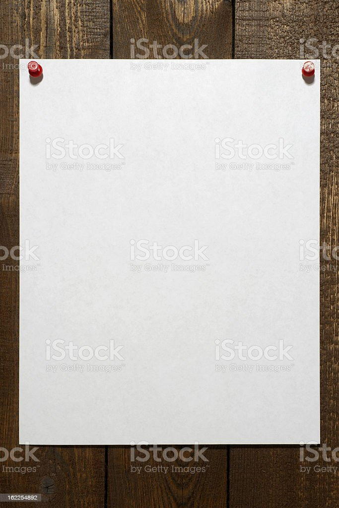 Blank Paper Pinned to Wall stock photo
