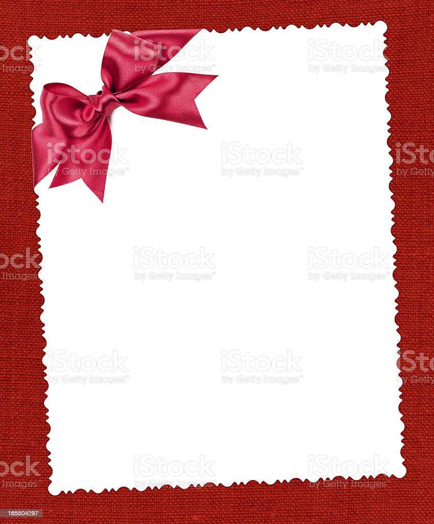 blank paper sheet with red bow on textile royalty-free stock photo