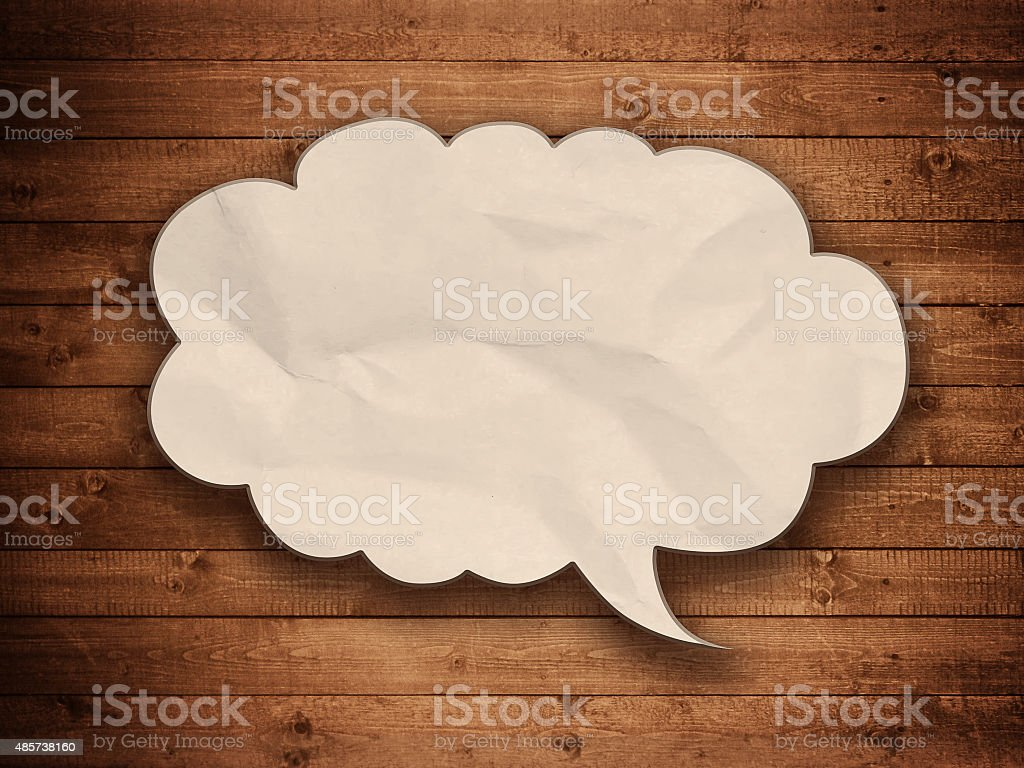 blank paper speech bubble on wood background stock photo