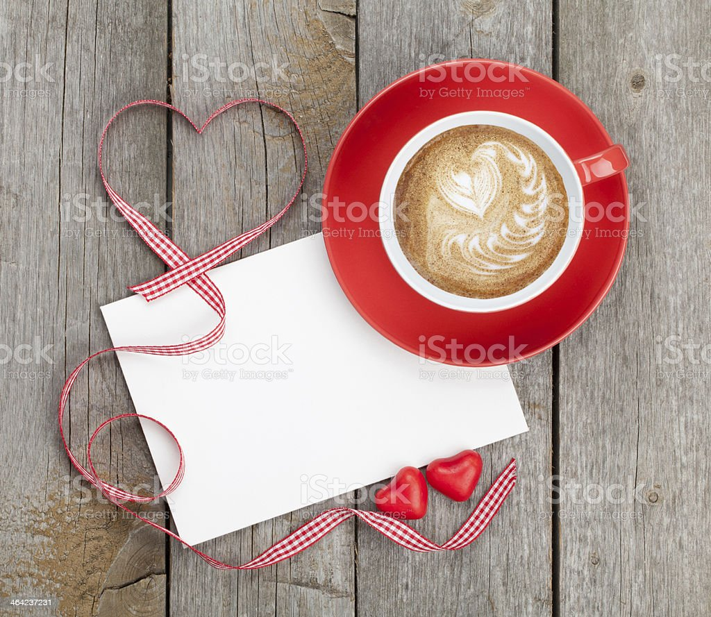 A blank paper with a coffee with a heart in cream stock photo