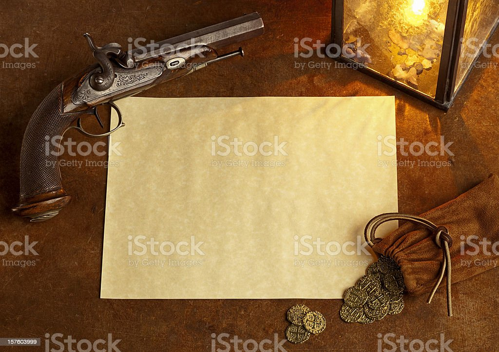 Blank Paper with Antique Pistol and Gold Coins. Horizontal. stock photo