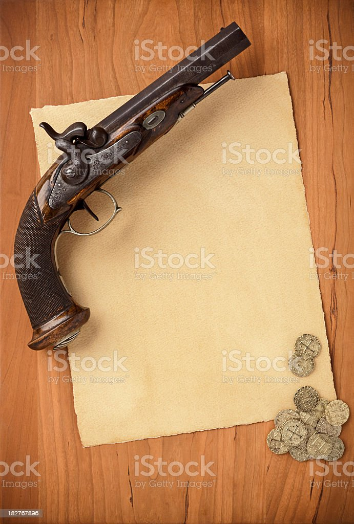 Blank Paper with Antique Pistol and Gold Coins. Vertical. royalty-free stock photo