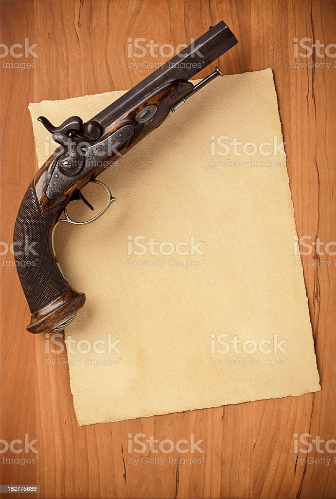 Blank Paper with Antique Pistol. Full Frame, Vertical. royalty-free stock photo