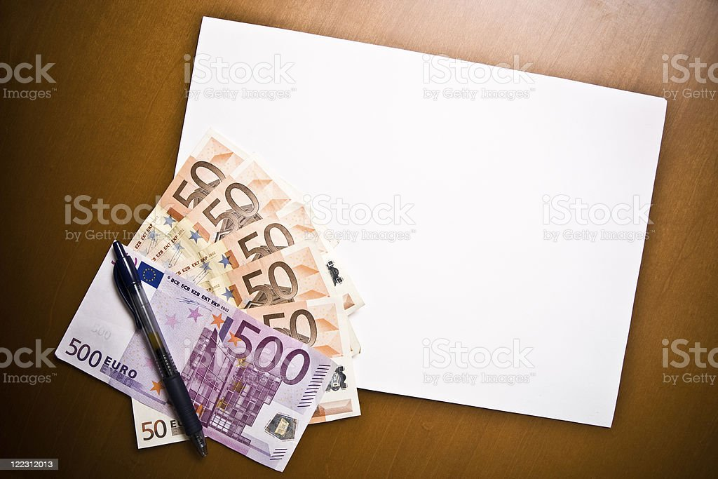 Blank paper with euro notes and one pen royalty-free stock photo