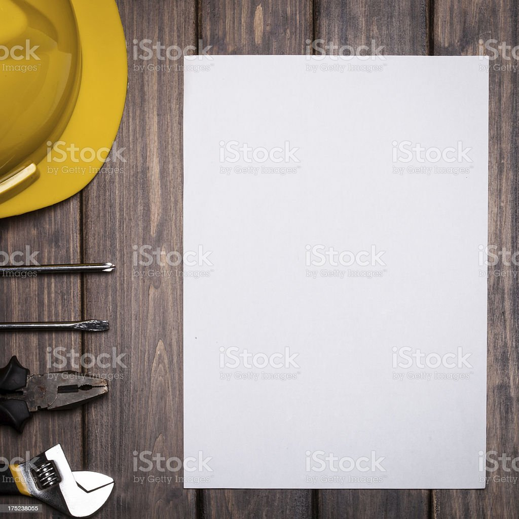 blank paper with tools over wooden background royalty-free stock photo