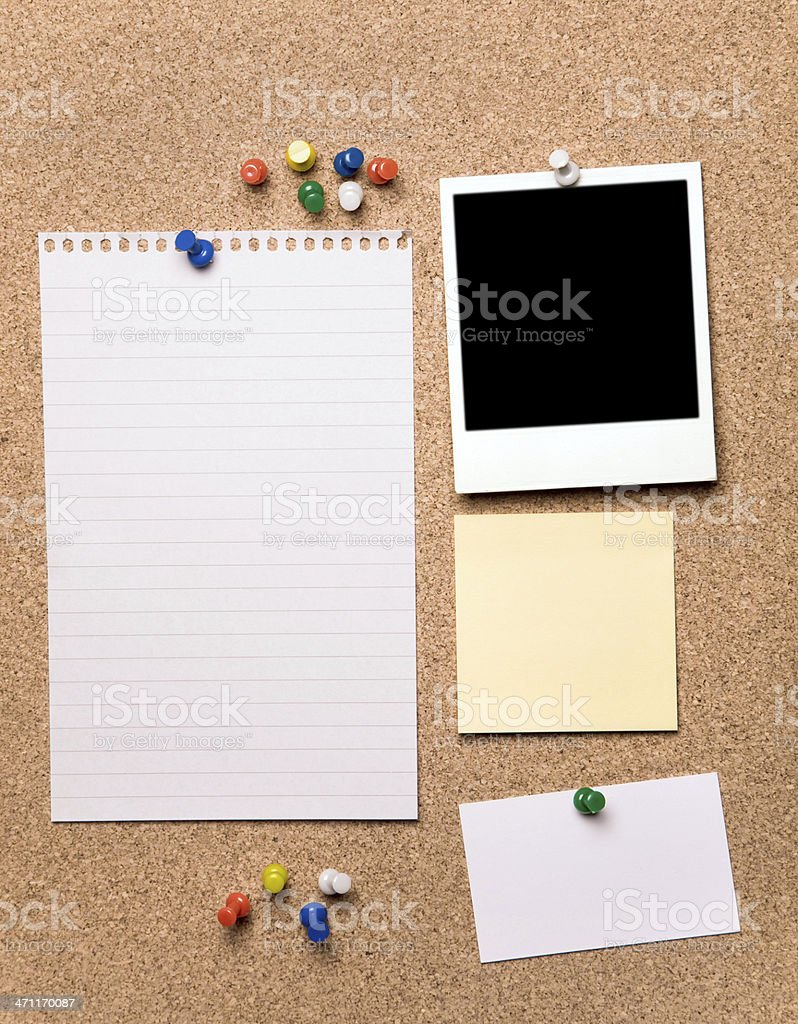 Blank papers and a blank photograph on a cork board stock photo
