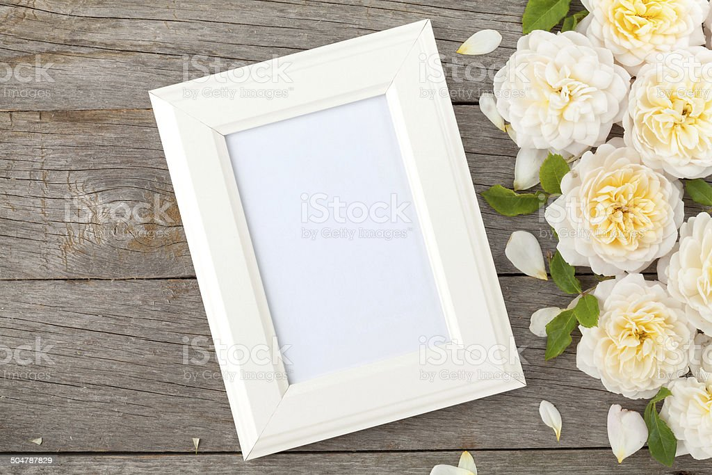 Blank photo frame and white roses stock photo